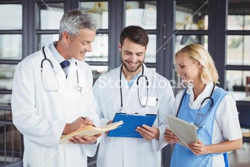 Senior doctor discussing with coworkers