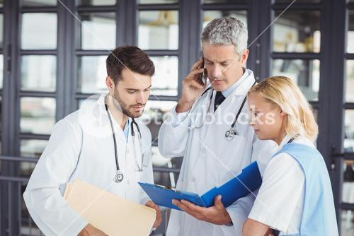 Senior doctor working with coworkers