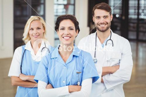 Portrait of cheerful doctors and nurse