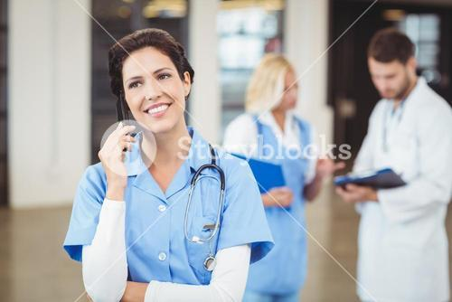 Nurse talking on mobile phone