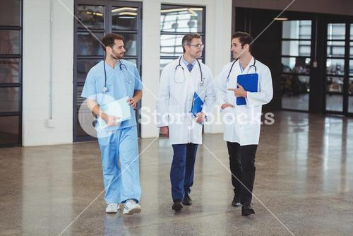 Full length of doctors discussing