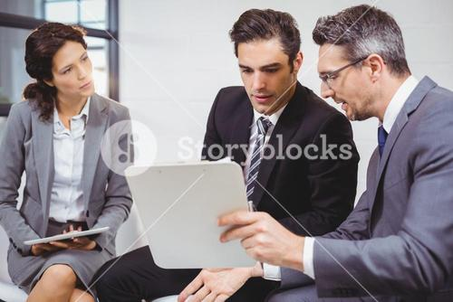 Business professionals holding documents on clipboard