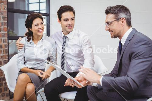 Businessman discussing with client