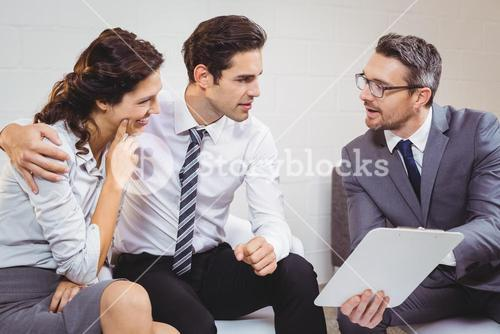Business professional discussing with client