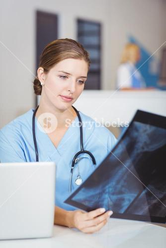 Female doctor holding X-ray
