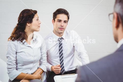 Clients discussing with businessman