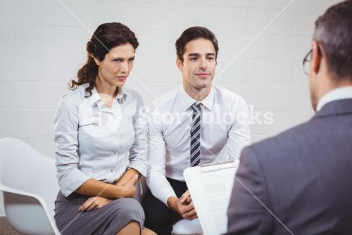 Clients interacting with businessman