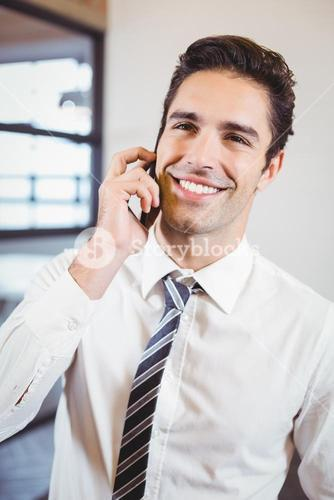 Smart business professional talking on mobile phone