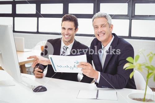 Portrait of business people working at computer desk