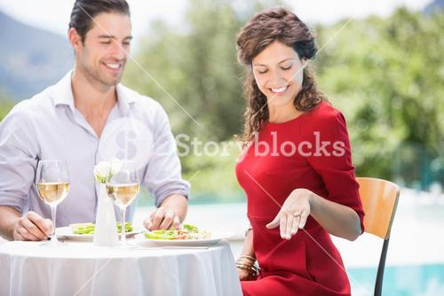 Smiling woman looking at engagement ring