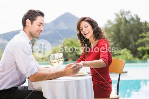 Couple looking at engagement ring