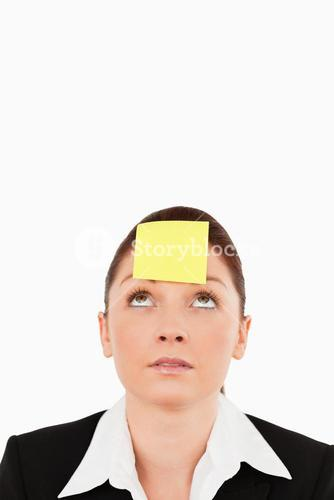 Close up of a businesswoman looking at the signe on her forehead