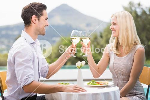 Couple toasting white wine