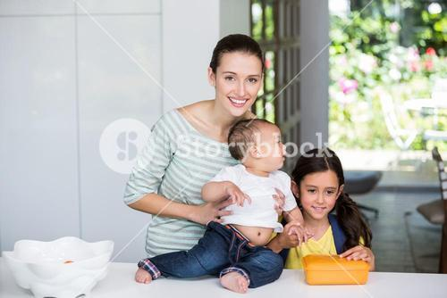 Portrait of smiling mother with children