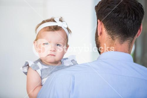 Portrait of cute baby girl with father