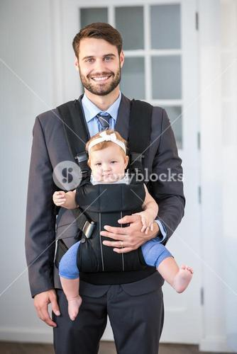 Confident businessman carrying daughter