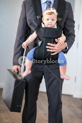 Businessman carrying daughter and briefcase