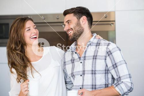 Cheerful young couple at home