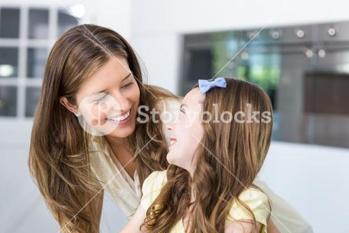 Mother and daughter looking face to face