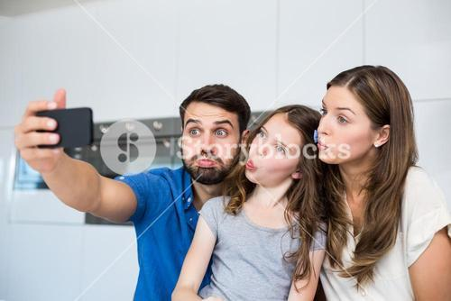 Family making faces while clicking selfie