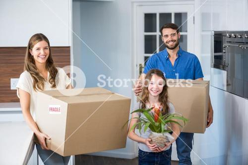 Portrait of family moving house