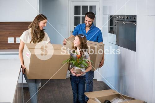 Smiling family moving house