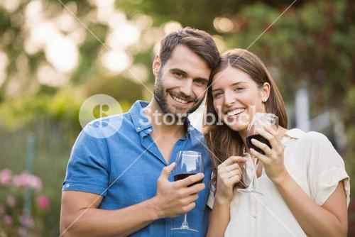 Portrait of couple with wine