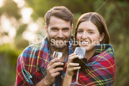 Portrait of smiling couple wrapped in blanket