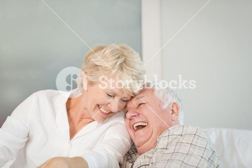 Happy senior couple laughing