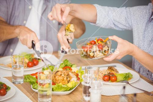 Midsection of family having meal
