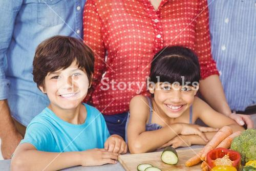 Portrait of siblings with family