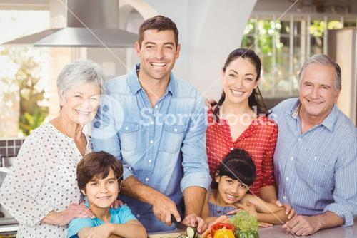Portrait of happy family in kitchen