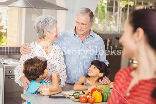 Happy family talking in kitchen