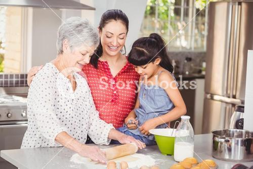 Grandmother with family making bread