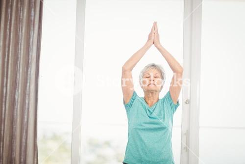 Senior woman performing yoga