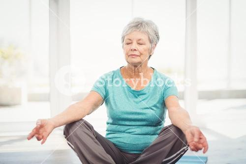 Woman performing yoga at home