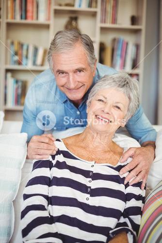 Portrait of senior couple in living room