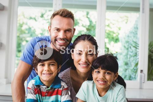 Portrait of smiling family with children