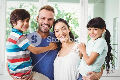 Portrait of confident family with children