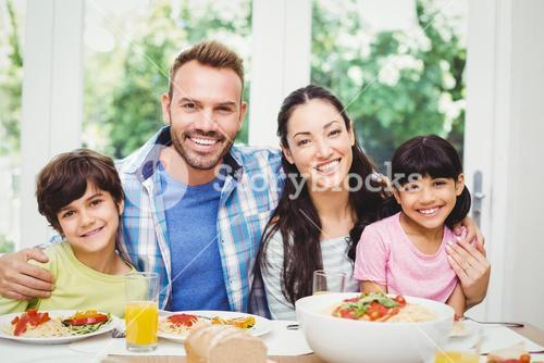 Portrait of cheerful parents and children