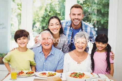 Multi generation family at dining table