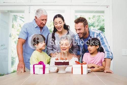 Happy family during birthday party of granny