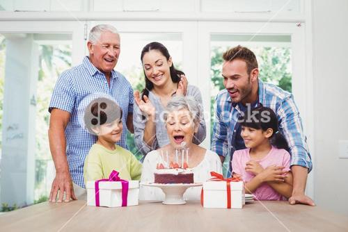 Smiling family during birthday party of granny