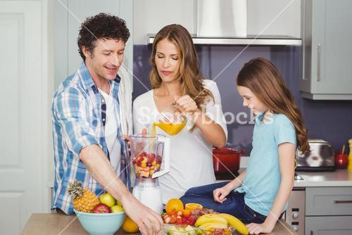 Family preparing fruit juice