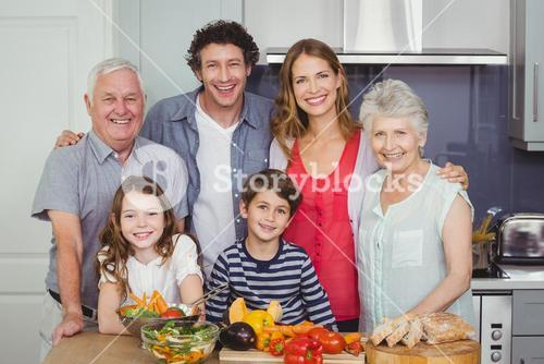 Portrait of happy family standing in kitchen