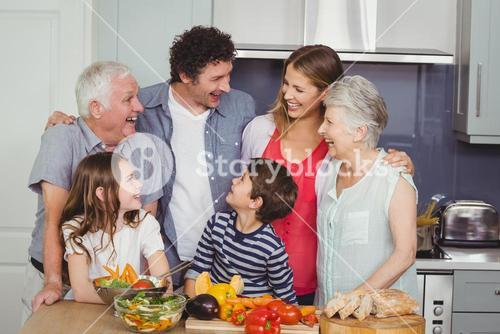Happy family standing in kitchen