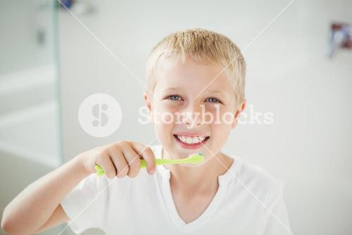 Portrait of boy brushing teeth