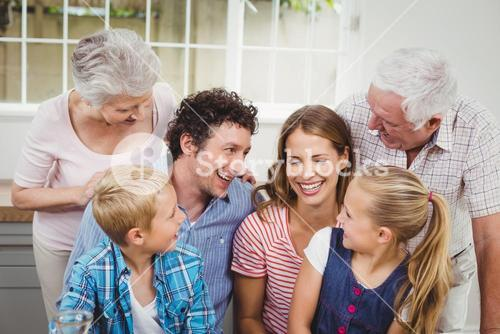 Cheerful multi-generation family at home