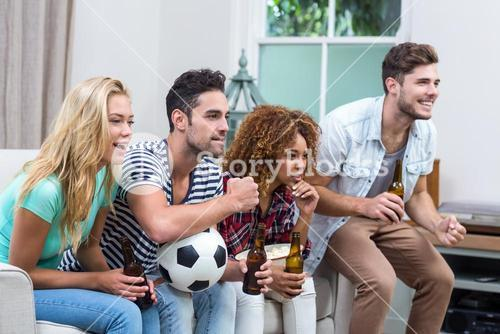 Multi-ethnic friends watching soccer match