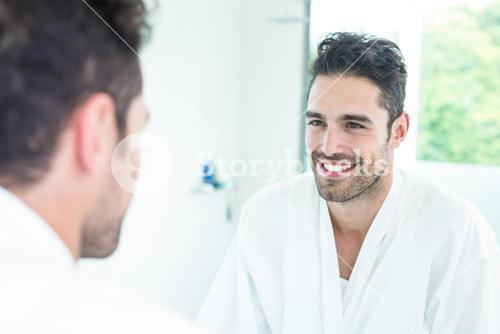 Handsome man looking in mirror